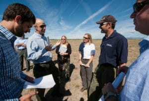 From left to right: James Jensen, Tom Johnson, Jody Rosier, and Rebecca Kauffman of Southern Ute Alternative Energy, and Otto VanGeet and Alex Dane of NREL, tour a potential solar array site on Southern Ute tribal land in Ignacio, CO. Photo by Dennis Schroeder, NREL