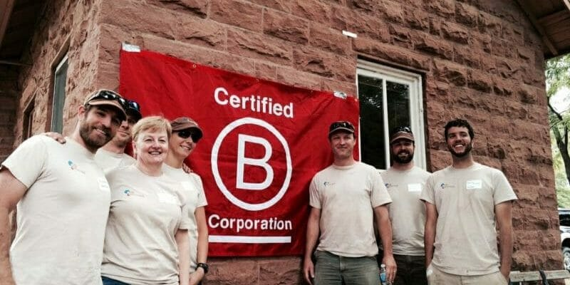 volunteers from b corp standing in front of house in lyons colorado