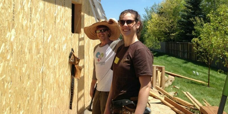 volunteers with hammers constructing habitat for humanity home in fort collins colorado
