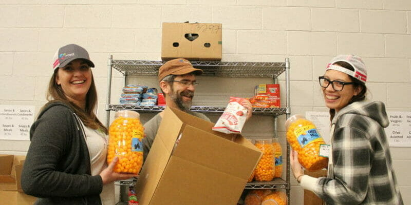 volunteers with cheese puffs at food bank in denver colorado