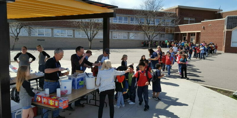 kids lined up for ice cream at godsman elementary school in denver colorado
