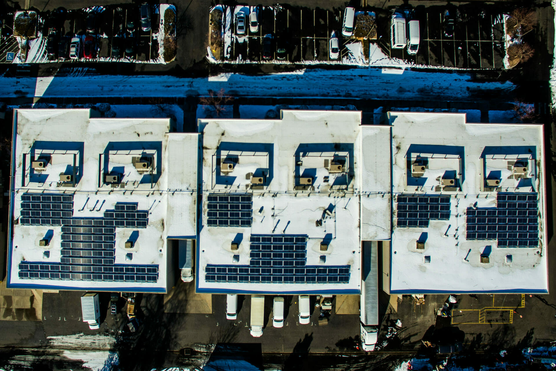 bird's eye view above commercial rooftop solar installation in arvada colorado