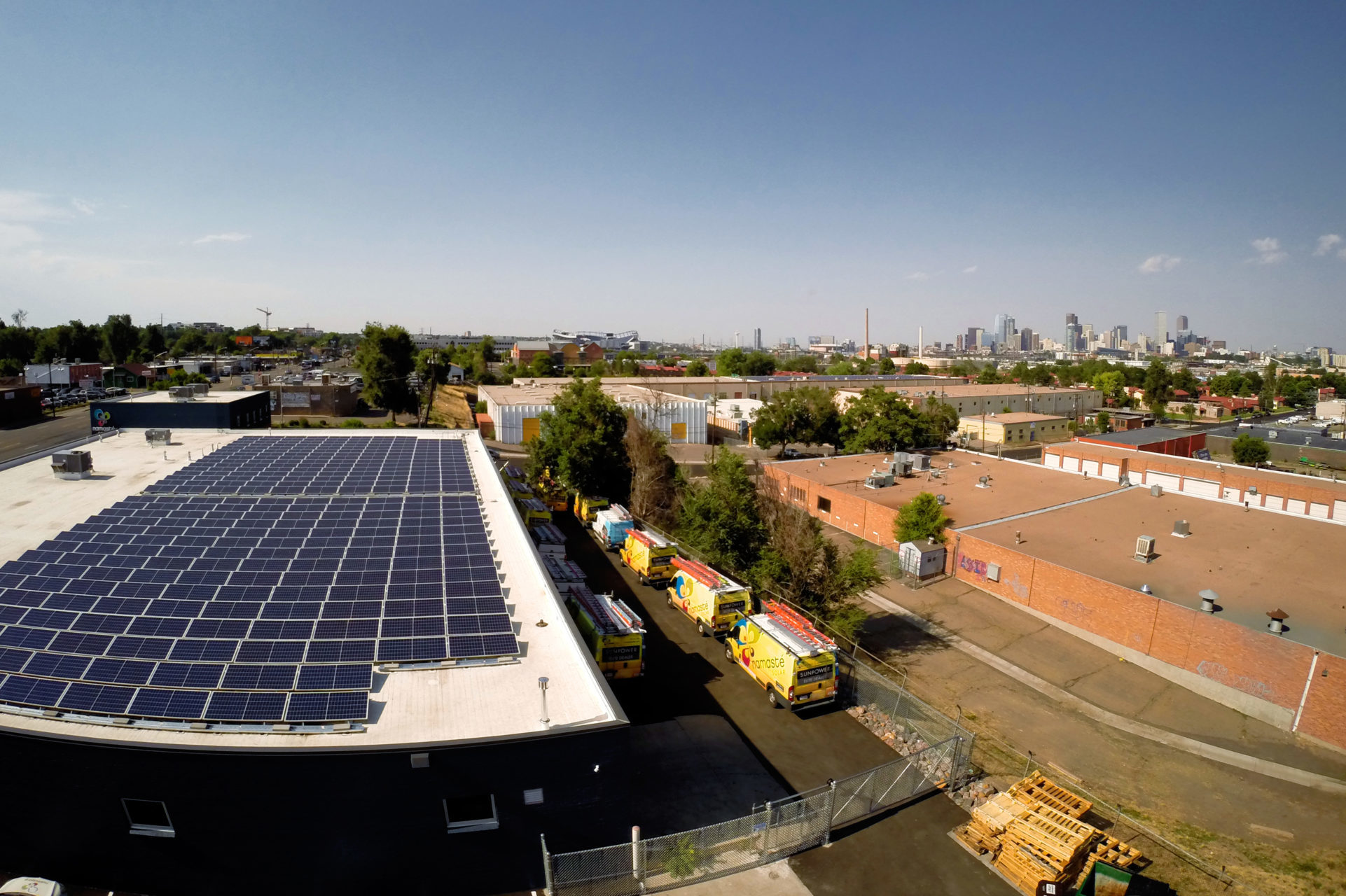 commercial solar panel installation in denver with namaste solar yellow vans