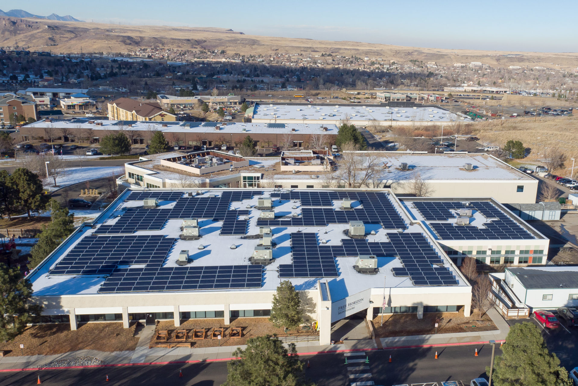 commercial solar panel installation on colorado rooftop
