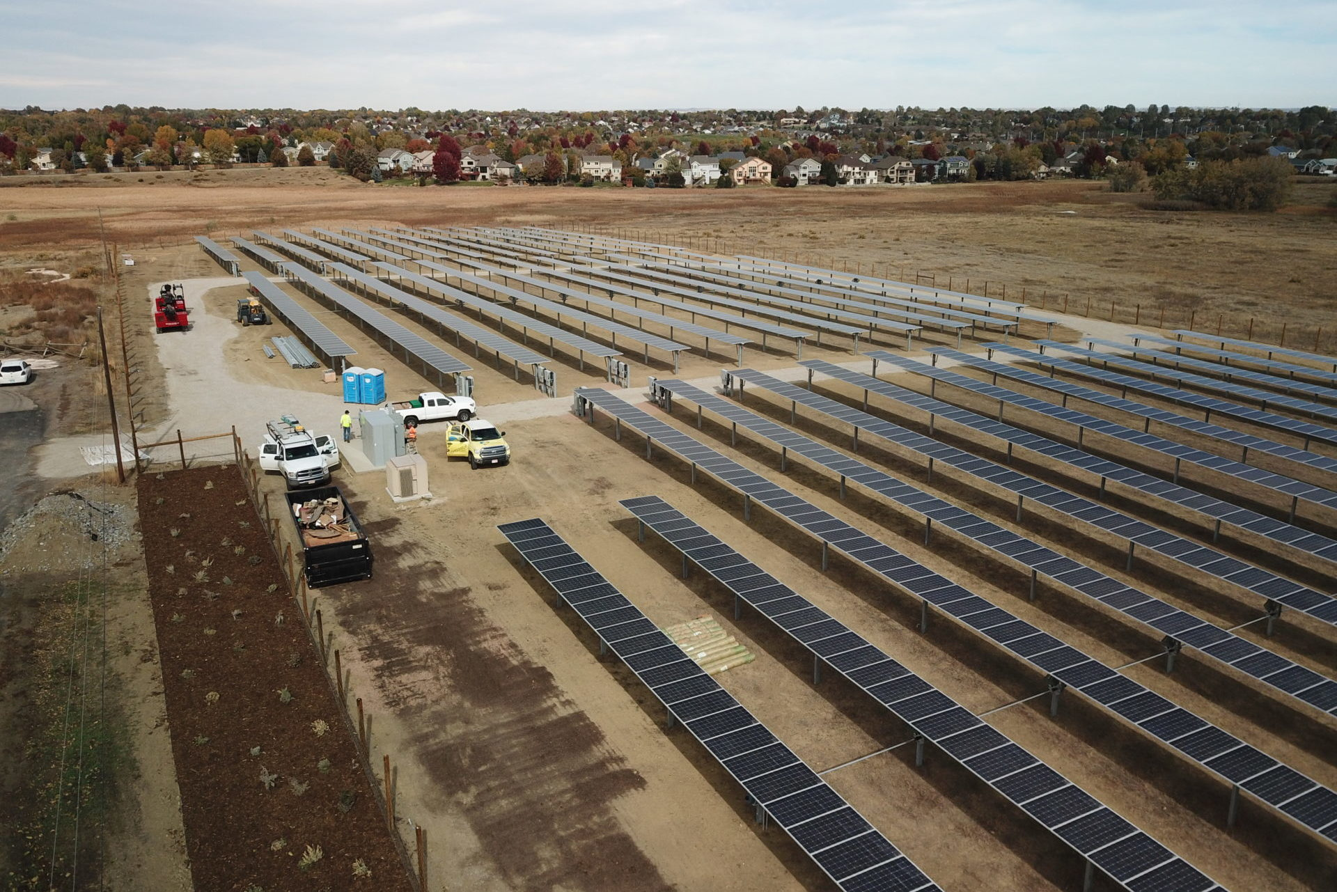 ground-mounted commercial solar fort collins colorado yellow namaste solar trucks