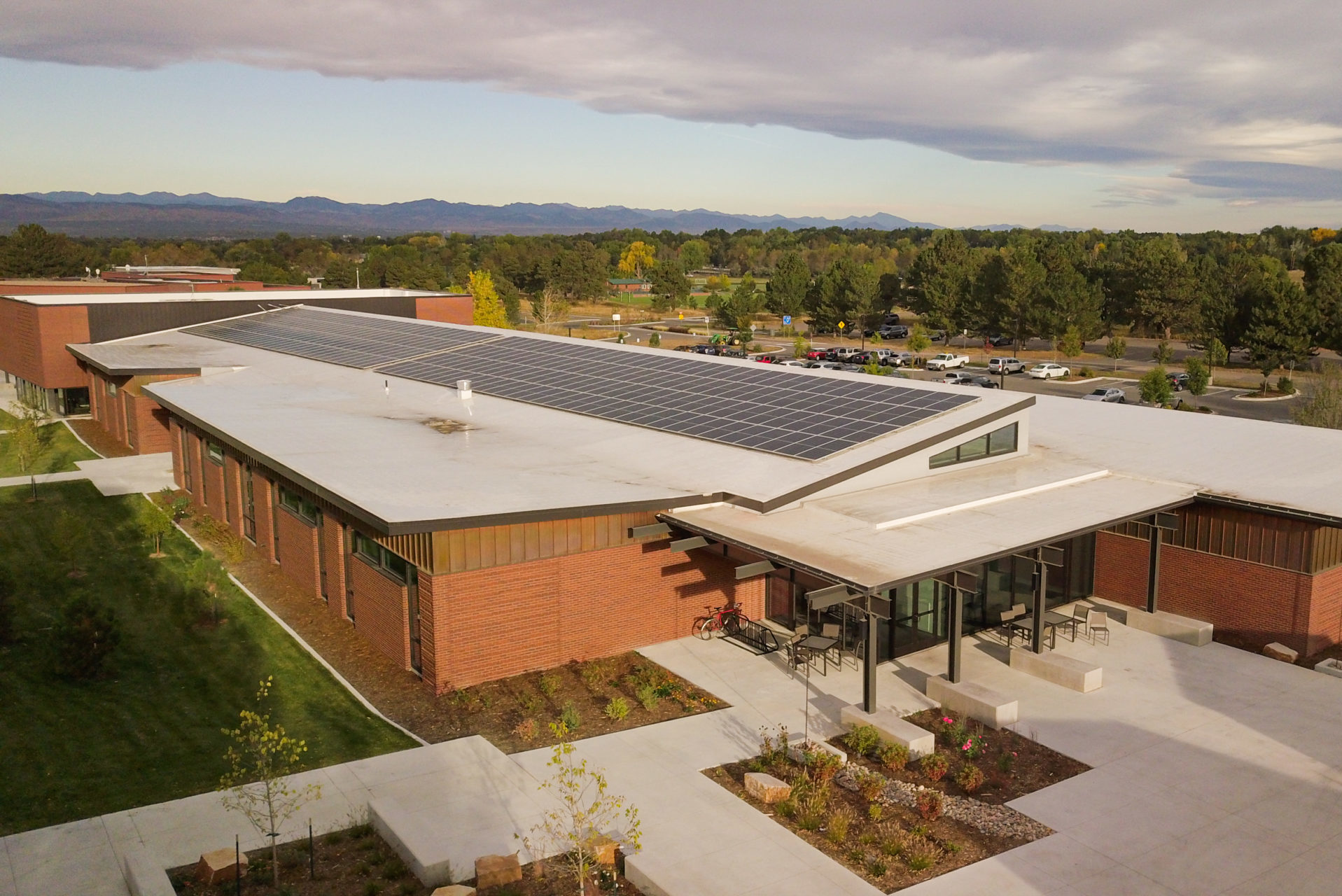 commercial solar panel installation on colorado school rooftop