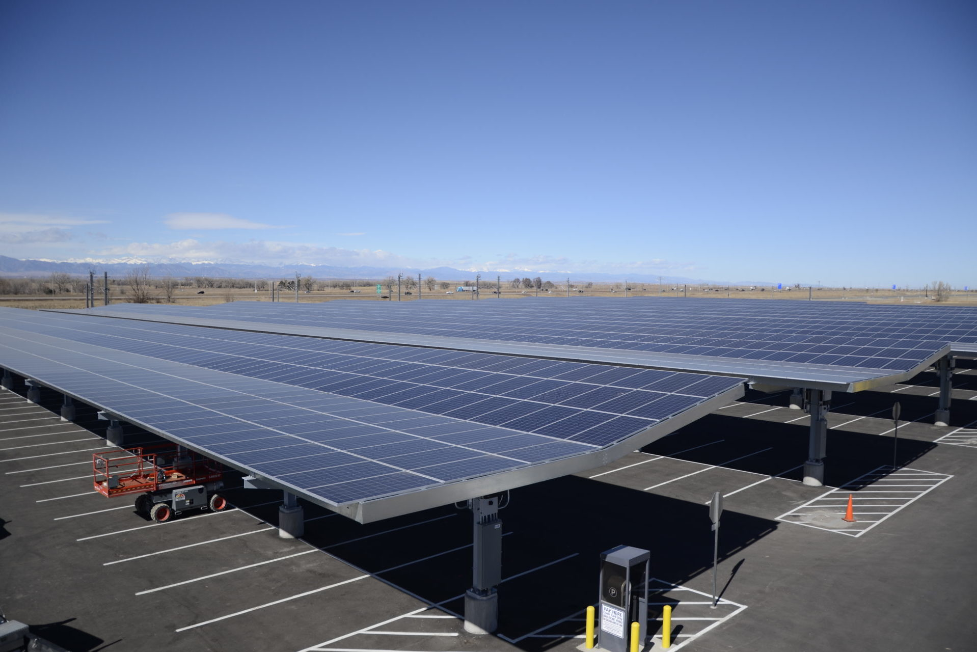 commercial carport solar panels over parking lot in denver